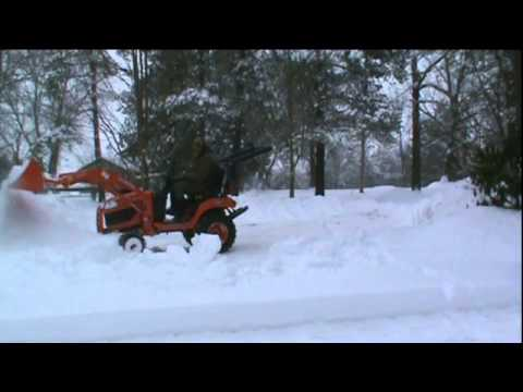 moving snow with my kubota bx 2370