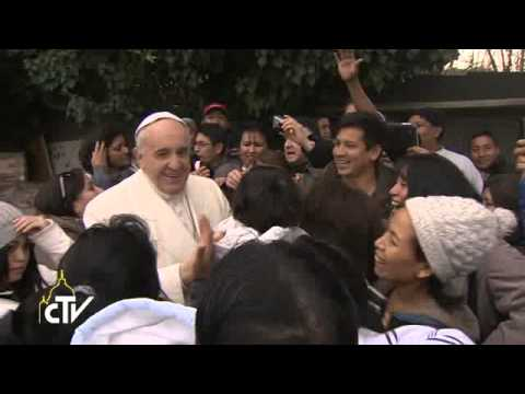 Pope Francis prays with refugees.