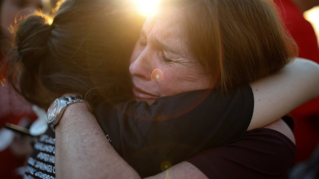 Outrage, tears at vigil for Florida shooting victims