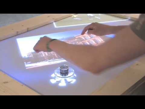 SLAP Widgets: Transparent Controllers Let You Feel Virtual Table Interfaces