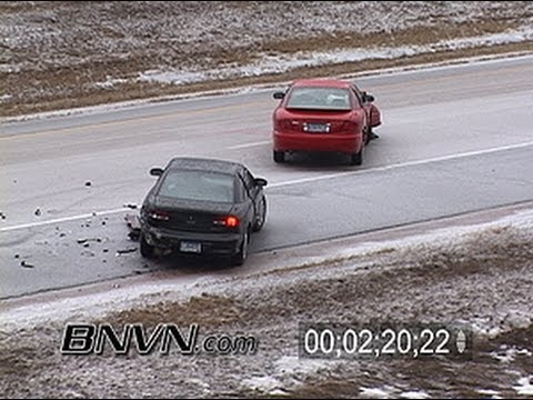 3/13/2004 Sleet and Ice Storm Car Crash Stock Video