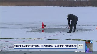 Driver OK after pickup falls through ice on Muskegon Lake