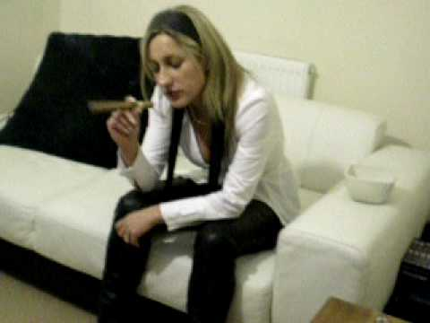 Sexy woman smoking fat cigar wearing leather pants. Video