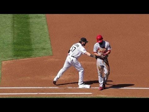 Helton pulls off hidden-ball trick on pickoff