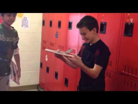 Kid smashes computer in the School hallway!