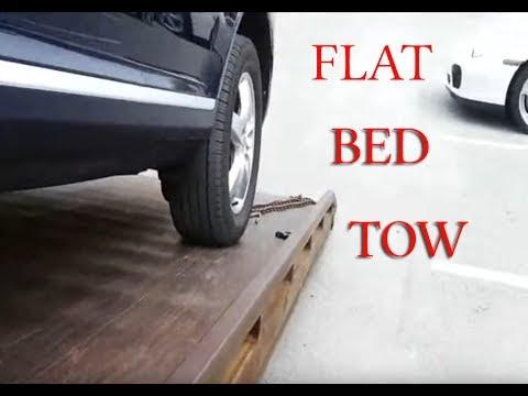 Running a flat bed tow truck