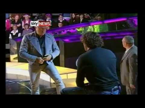 Billionaire Punch a man in face on National TV.
