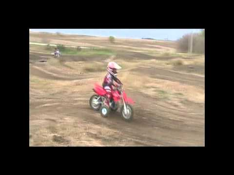 3 year old Jacob Paulsen riding his CRF50 with training wheels