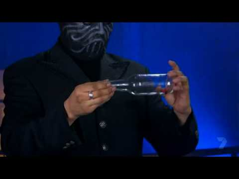 The Masked Magician Secrets Revealed - the magic bottle top
