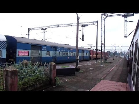 Date taken: October, 2013. Watch the ruthless overtake by newest Vishakhapatnam WAP-4#22949 with bang on time Hyderabad bound East-Coast express. Location: B...