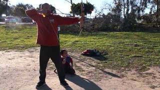 Max using the Barnett Lil' Sioux Jr youth archery bow and arrow set toy