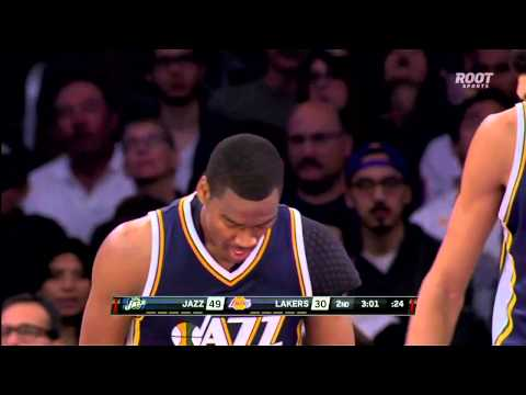 Alec Burks crosses over Kobe Bryant, scores