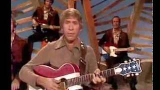 Watch Buck Owens Aint It Amazing Gracie video