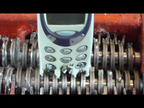 Papper shredder: shredding Nokia 3310 mobile phone