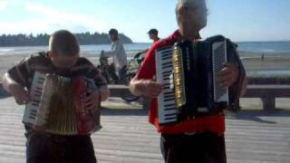 An accordion started to play in Parksville BC Canada / by buskerjames and buskerrobin
