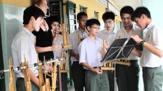 The Traveling Teacher Learns to Play the Angklung Instrument (Malaysia)