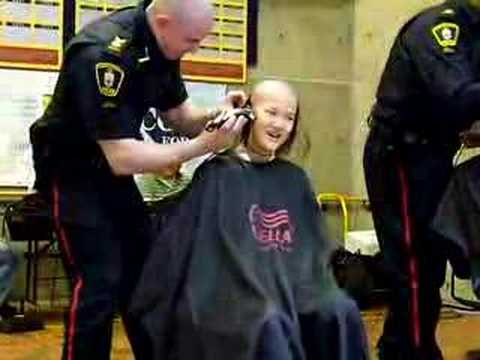 My head being shaved by UTSC cop. This is a charity event and I raised $764 to have my head shaved for the Canadian Cancer Society.