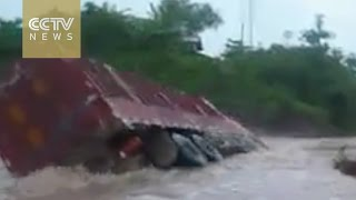 Brave or foolhardy?Video of Chinese truck driver engulfed by floods goes viral