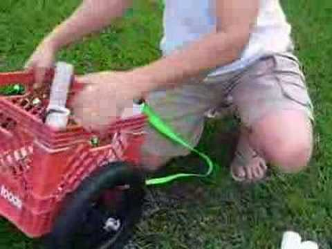Homemade milkcrate kayak cart assembly youtube for Homemade fishing cart