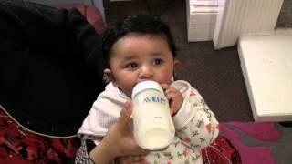Baby drinking bottle milk - 4 months old