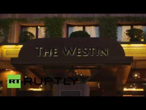 Italy: President Putin departs Milan's Westin Hotel following talks