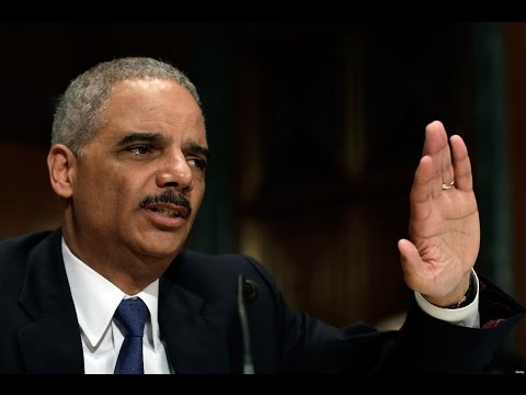 Cheering & Conspiracy Theories Surround Eric Holder Resignation