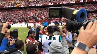 Cam Newton and Josh Norman meet after game