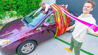 TAPING HIM TO MY CAR ROOF!!