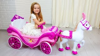 Ulya dresses up in a princess and plays with a carriage