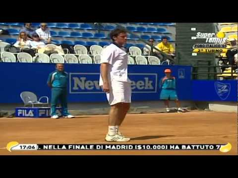 Federer/Safin split screen racquet smash