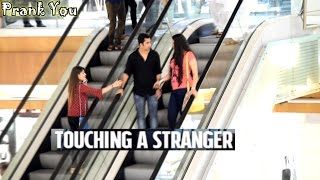 Girl Touching Strangers Hands On The Escalator Prank