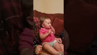 1 year old tries Salt & Vinegar chips for her first time...