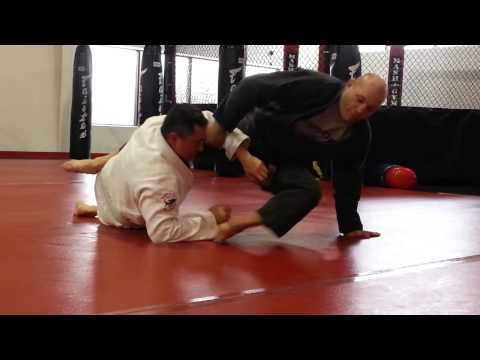 switch sides armbar drill Image 1