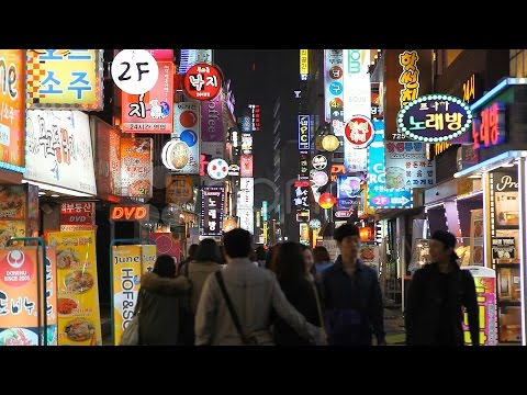 Shoppers In South Korea, Seoul Neon Street Electronic By Night, Asian Shopping. Stock Footage