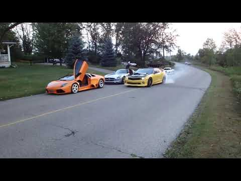 Camaro does burnout past Audi R8, Ferrari, Porsche, Mercedes SLS and Lamborghini Murcielago LP640