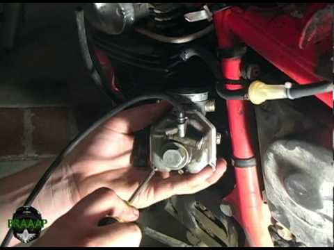 How to Clean a Spark Plug And A Carburetor On A Honda XR 200
