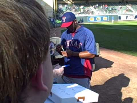 Elvis Andrus of The Texas Rangers signing autographs