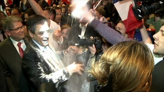 Fillon pelted with flour at campaign rally