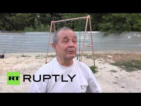 Ukraine: Shelling shatters houses in central Donetsk