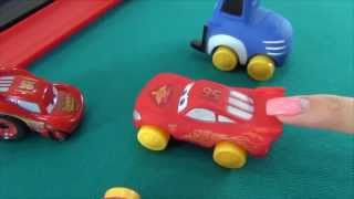 The Cars in English. Playing with toys from the Disney cartoon the cars. Lightning McQueen stunt car
