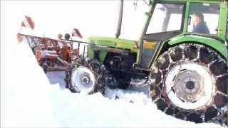 Deutz 6207 im Einsatz !  snow plowing with snow chains (spikes)