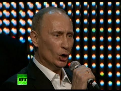 Singing PM: 'Fats' Putin over the top of 'Blueberry Hill' with piano solo
