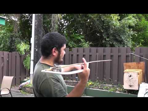 Throwing the PVC Atlatl With Dart Rest