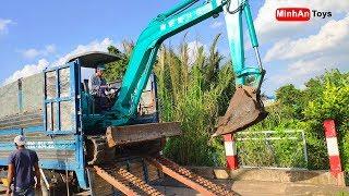 Excavator climbing onto Truck | Excavators for Kids