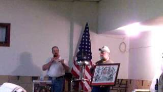 Dallas Hansen Auctioneer selling Pheasants Forever and Ducks Unlimited prints for a benefit auction