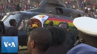 Mugabe Casket Arrives at Stadium in Zimbabwe