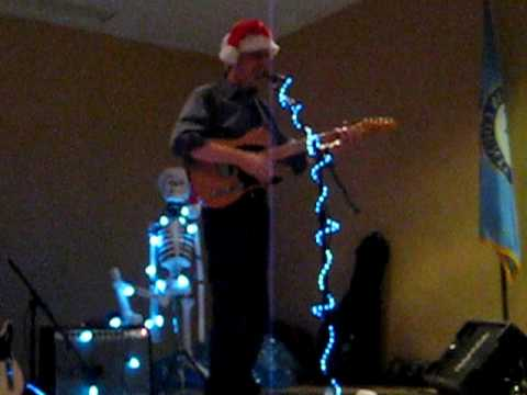 Bill Kirchen performs Daddy's Drinkin Up Our Christmas