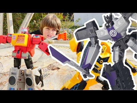 Роботы #Трансформеры: Оптимус Прайм, Бамблби и их секретная база! Чей бластер победит?