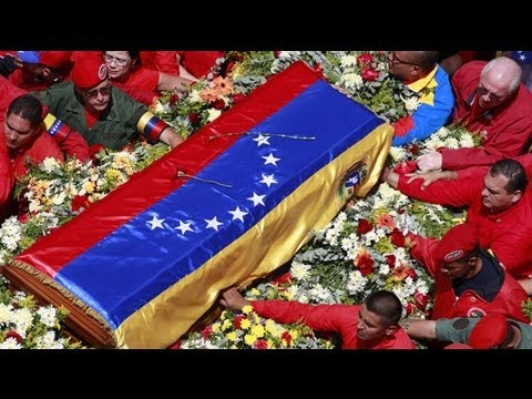 Hugo Chavez's body carried through Caracas