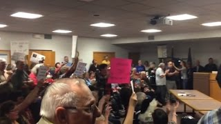 Angry crowds at town halls across the US
